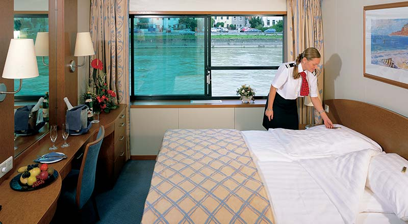 Viking crew cleaning deluxe stateroom