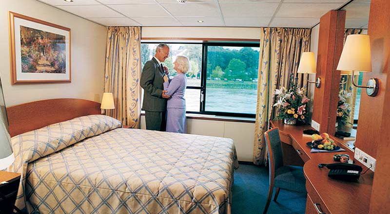 Couple inside deluxe stateroom