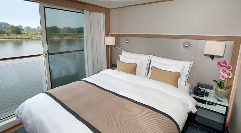 Bed of a Veranda stateroom on board a Viking river ship