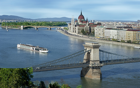 A Viking longship sailing past the Budapest Parliament in Hungary