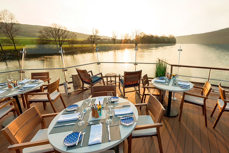 Set tables on the Aquavit Terrace of a Viking river ship