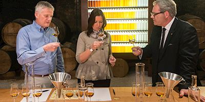 A couple at a cognac tasting