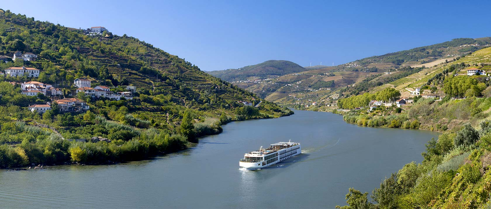 A Viking river ship sailing along the Douro River