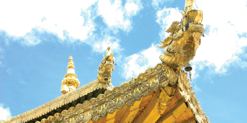 Close up of a Lhasa Roof with a golden dragon carving.