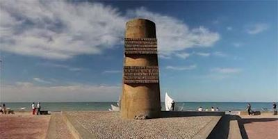A memorial statue on the beach at Normandy.