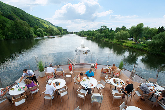 Aerial view of people sitting at tables on the Aquavit Terrace of a Viking river ship